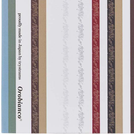 オロビアンコの日本上陸20周年記念デザインのマルチストライプの測量野帳
